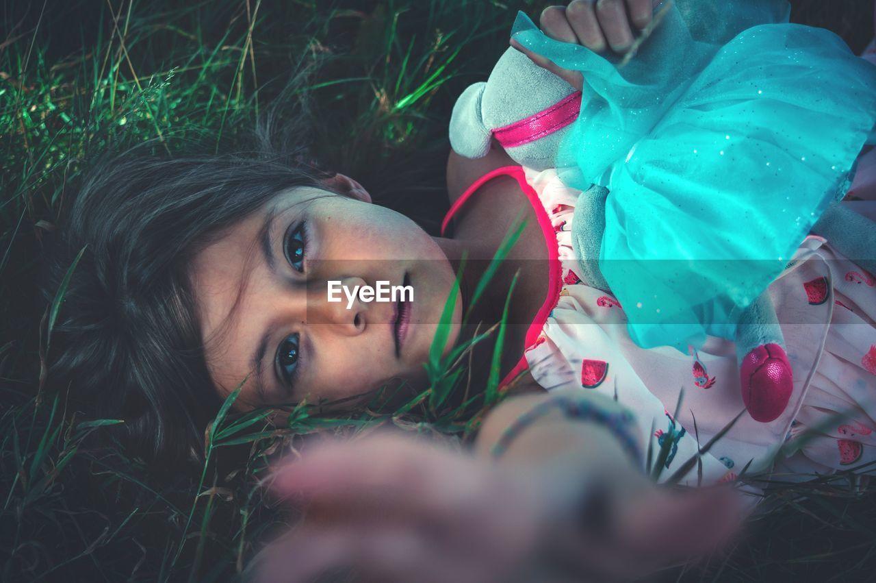 Portrait Of Girl Lying On Grass