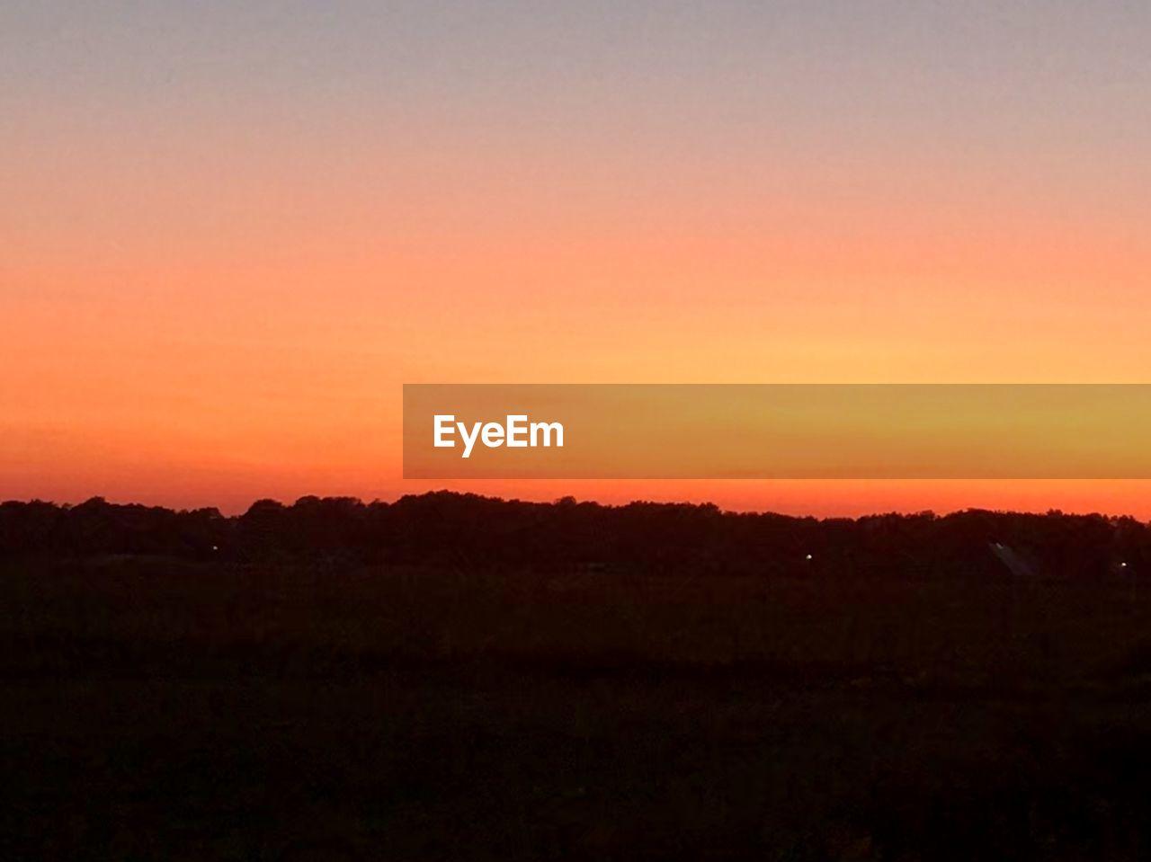 sunset, sky, scenics - nature, landscape, environment, beauty in nature, silhouette, tranquility, tranquil scene, orange color, nature, copy space, no people, dramatic sky, outdoors, non-urban scene, idyllic, horizon, land, sun, romantic sky, dark