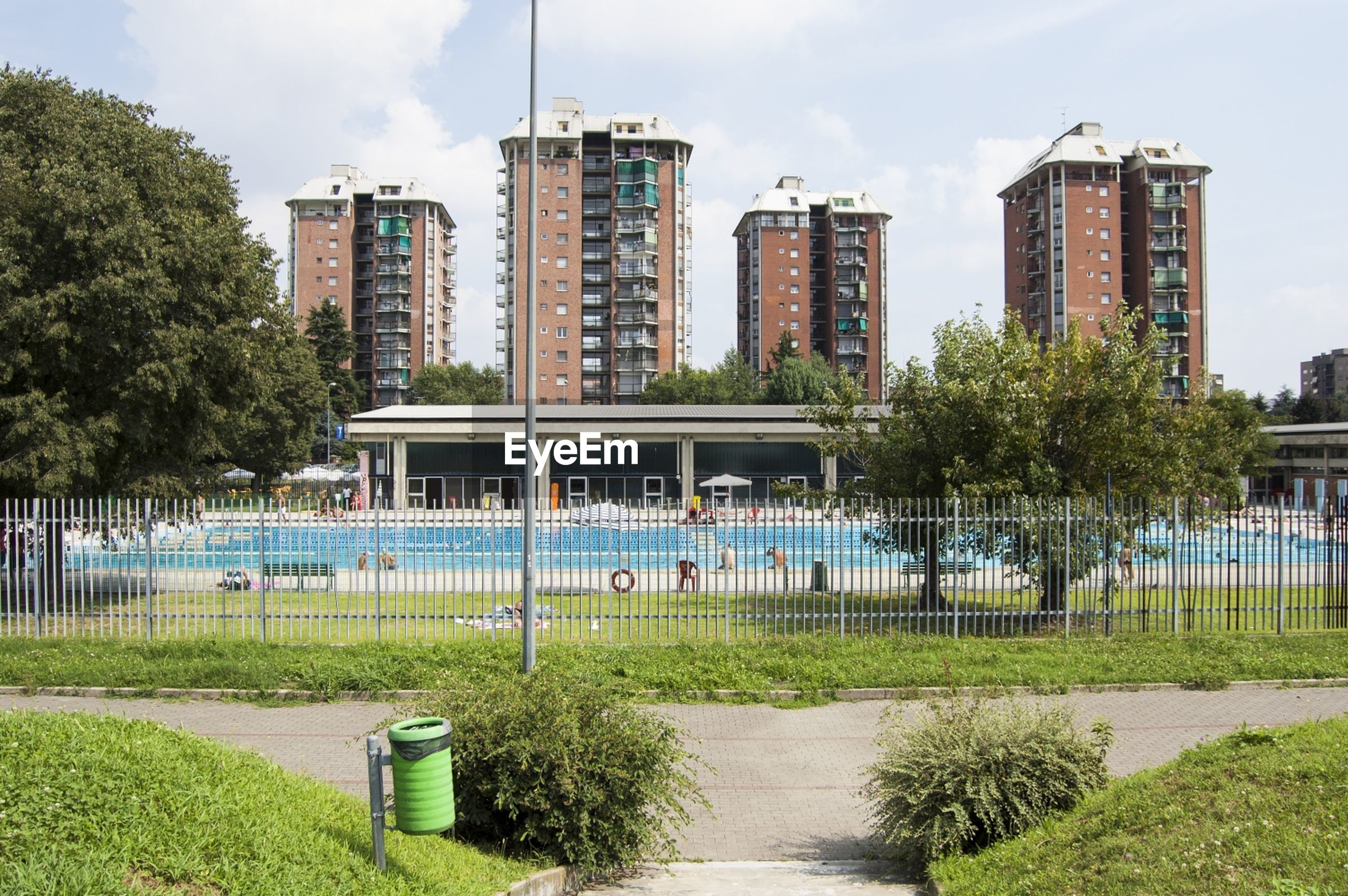 View of swimming pool and buildings