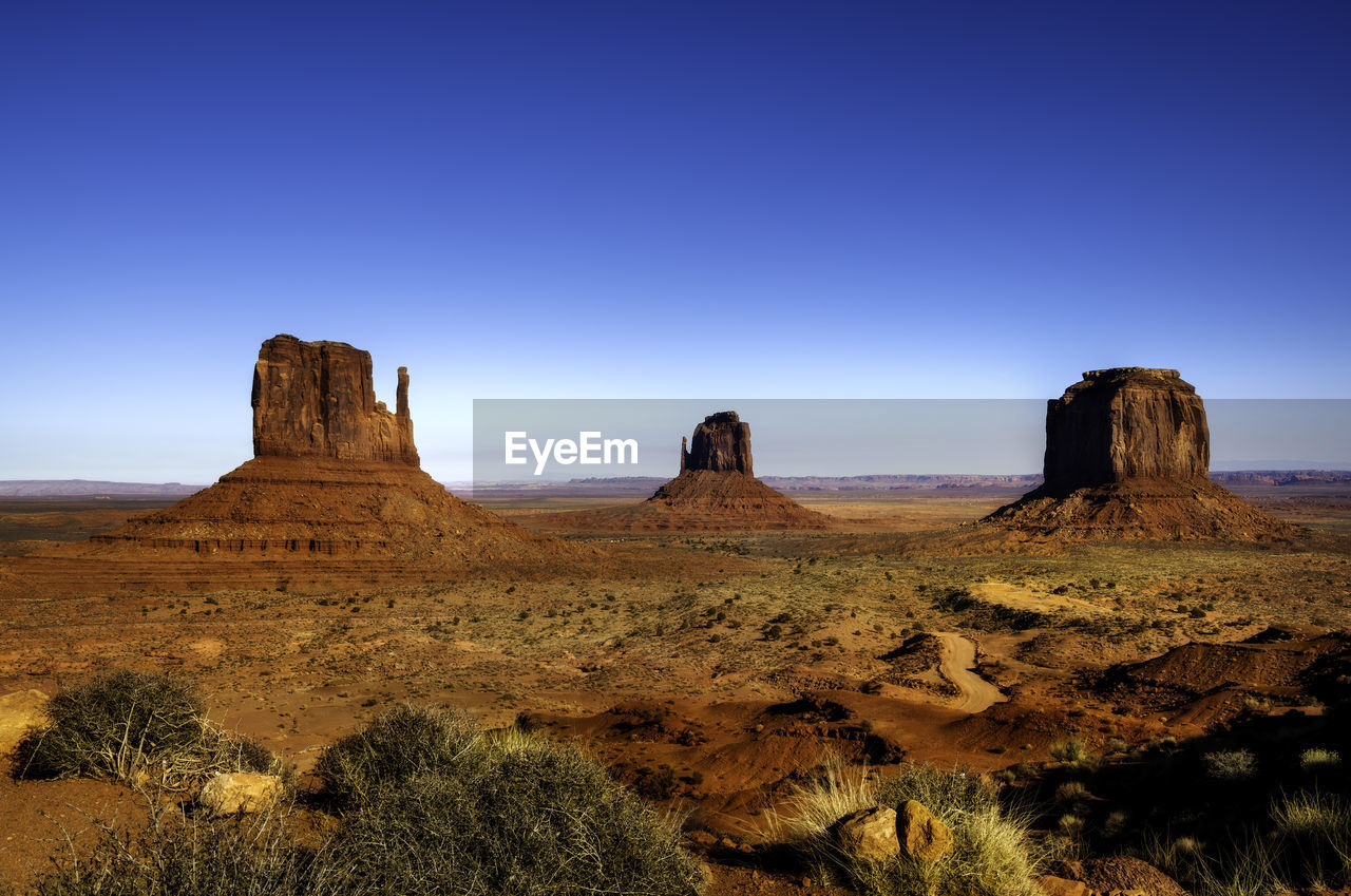 sky, scenics - nature, non-urban scene, landscape, tranquility, tranquil scene, beauty in nature, rock formation, rock, geology, environment, land, rock - object, no people, nature, blue, travel destinations, physical geography, idyllic, clear sky, arid climate, climate, outdoors, formation, semi-arid, eroded, sandstone