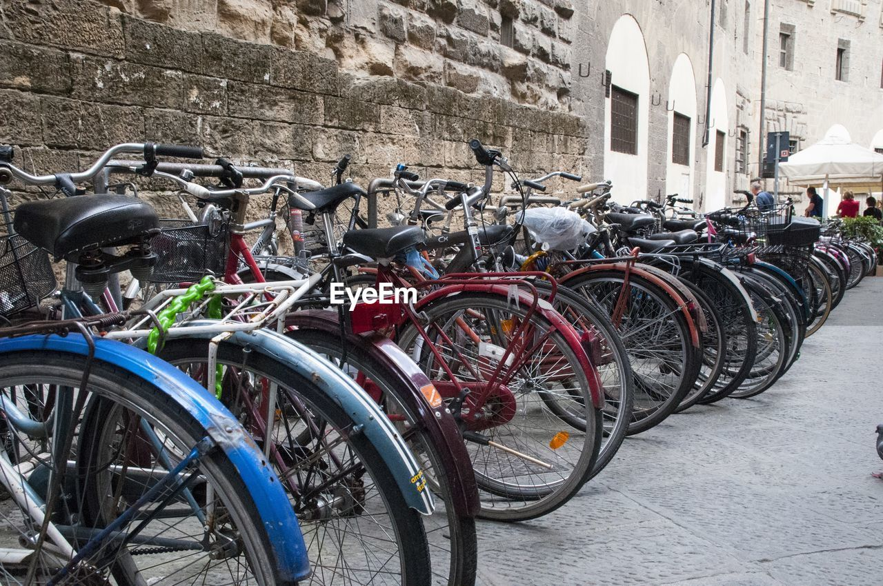 bicycle, transportation, mode of transport, stationary, land vehicle, architecture, built structure, parking, bicycle rack, day, building exterior, outdoors, no people, city, tire