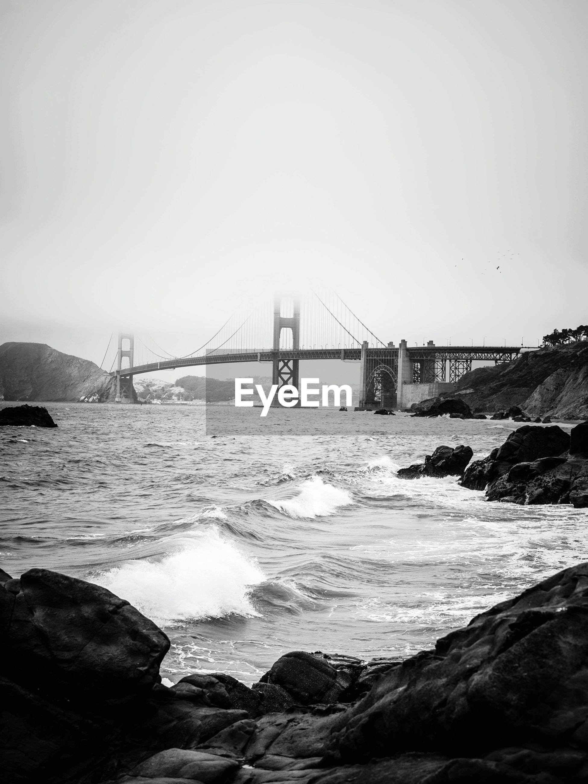 VIEW OF SUSPENSION BRIDGE AT SEA