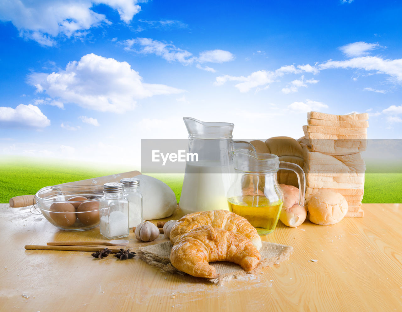 High Angle View Of Croissant And Ingredients On Table Against Sky