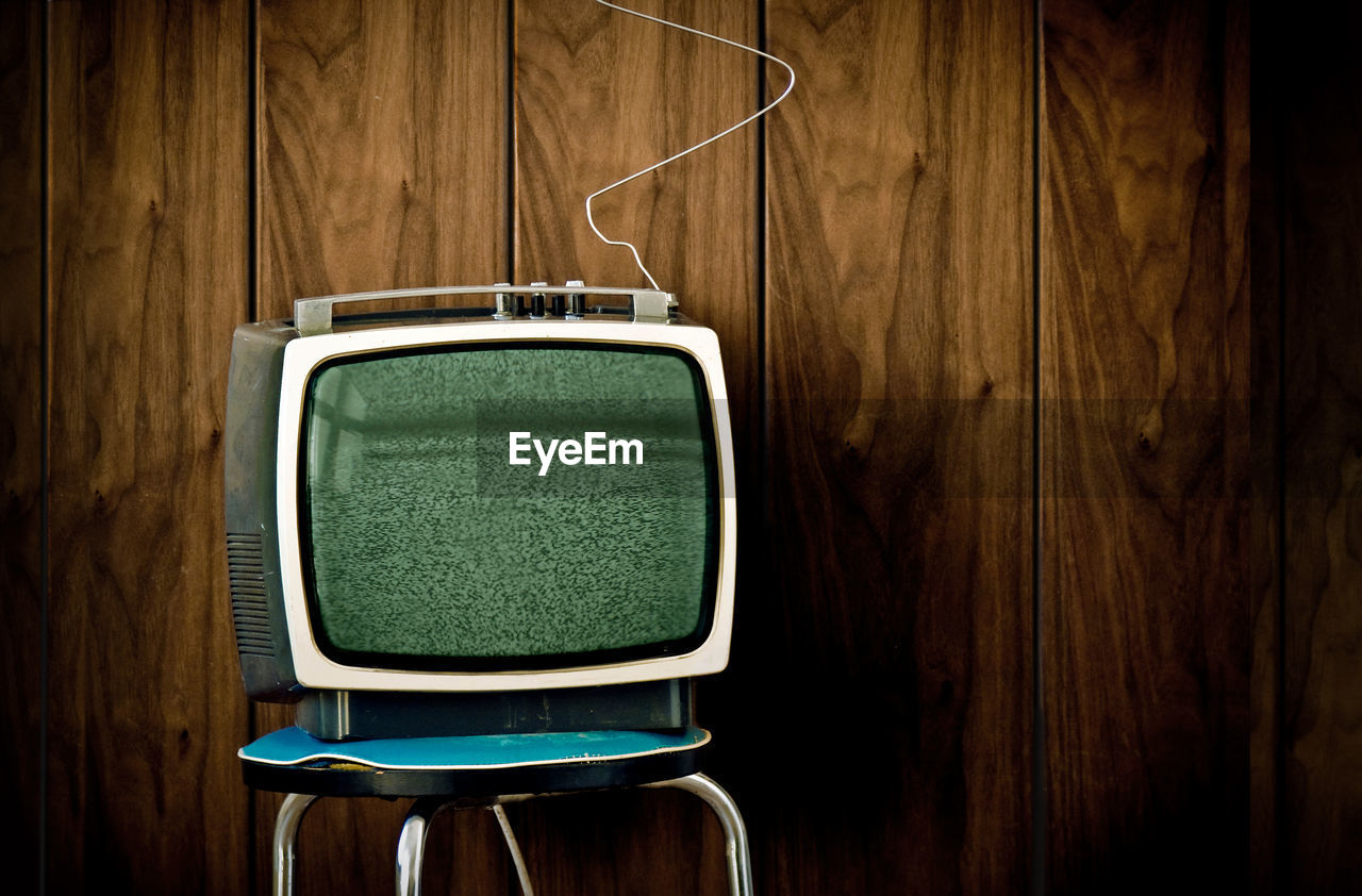 Close-up of television set against wall