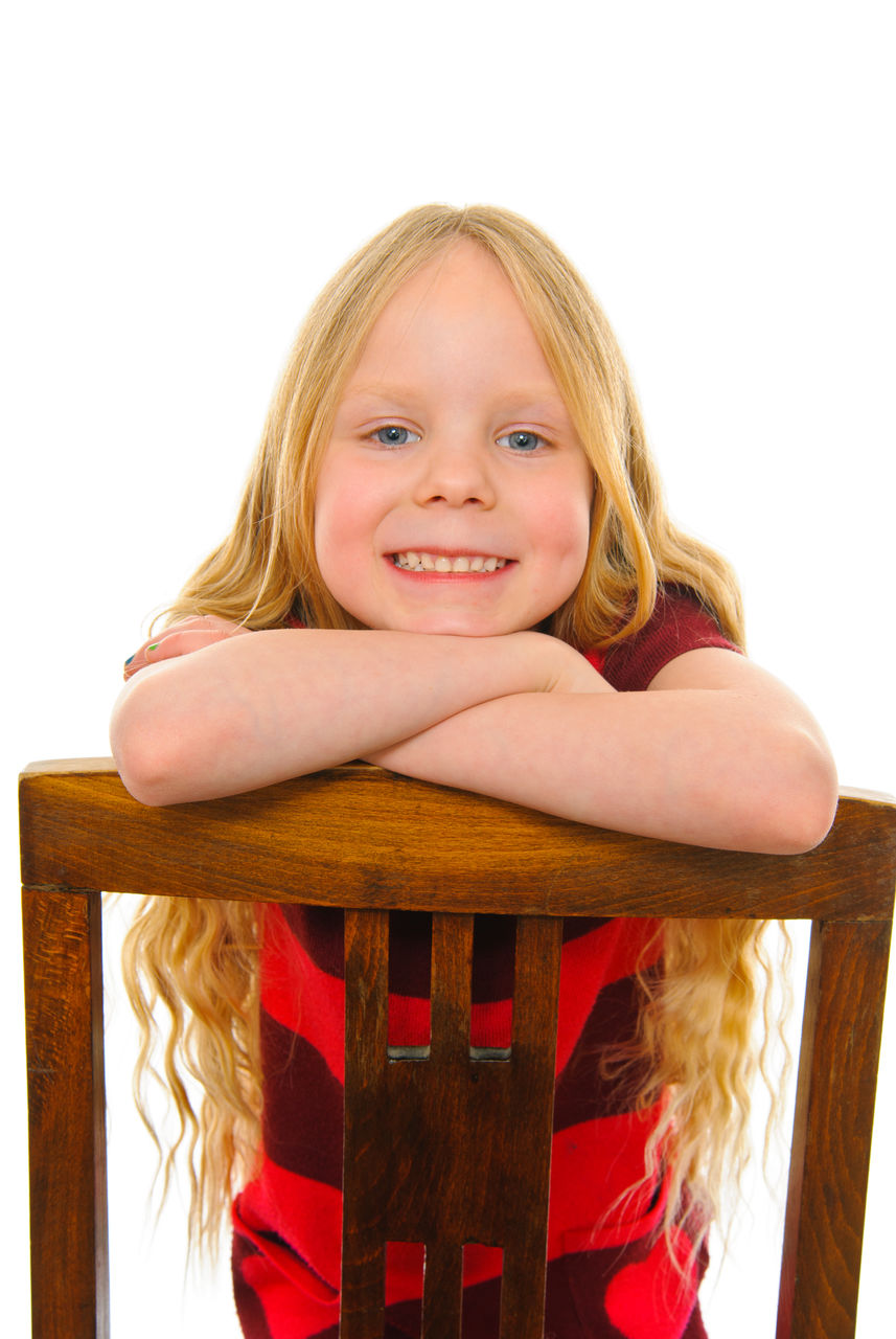 portrait, looking at camera, blond hair, childhood, girls, hair, one person, smiling, indoors, child, front view, white background, females, women, emotion, studio shot, happiness, lifestyles, innocence, hairstyle