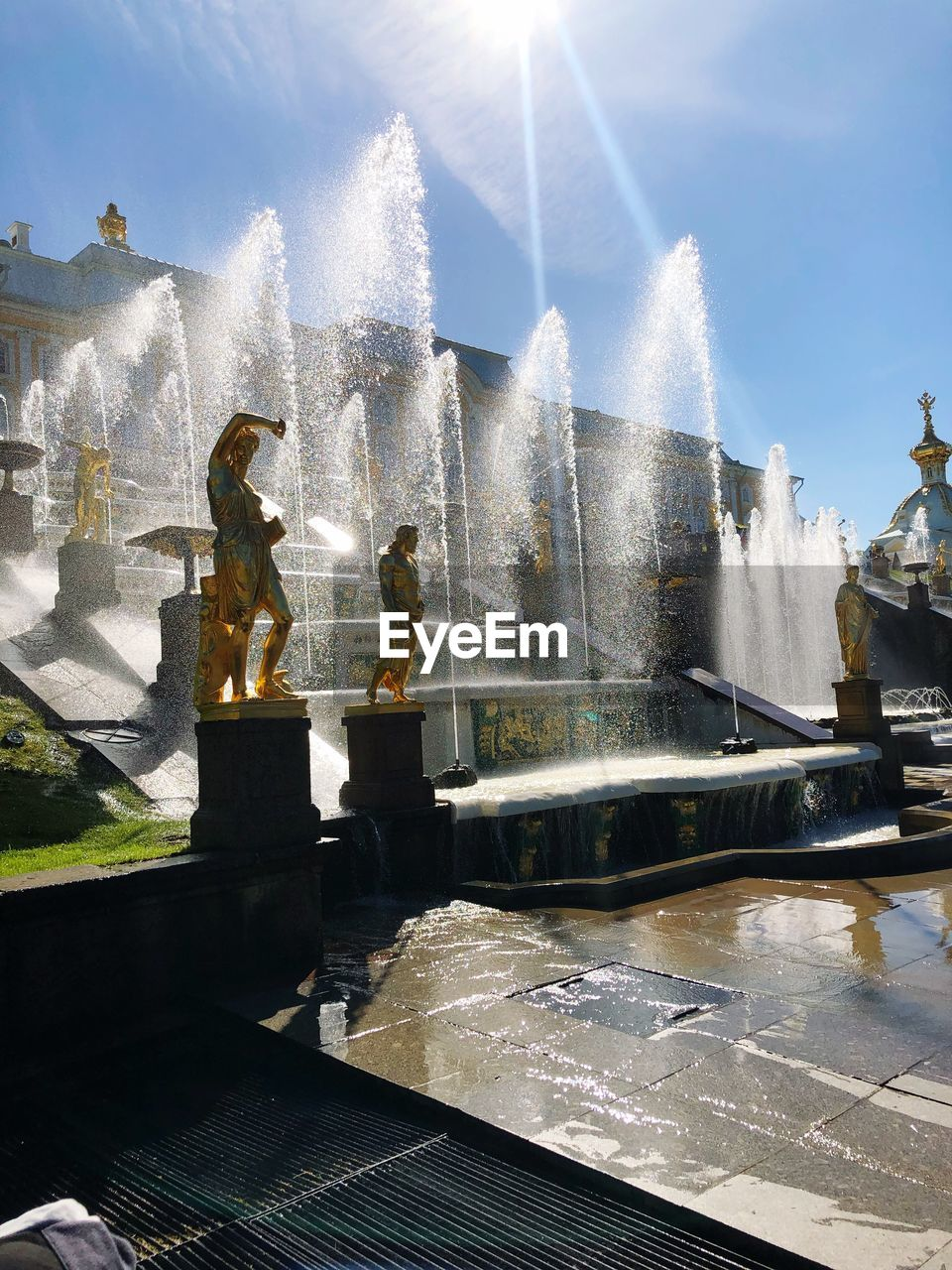 water, sunlight, fountain, nature, sky, spraying, day, sunbeam, sculpture, splashing, statue, architecture, lens flare, human representation, representation, art and craft, motion, real people, sunny, outdoors, sun, flowing water