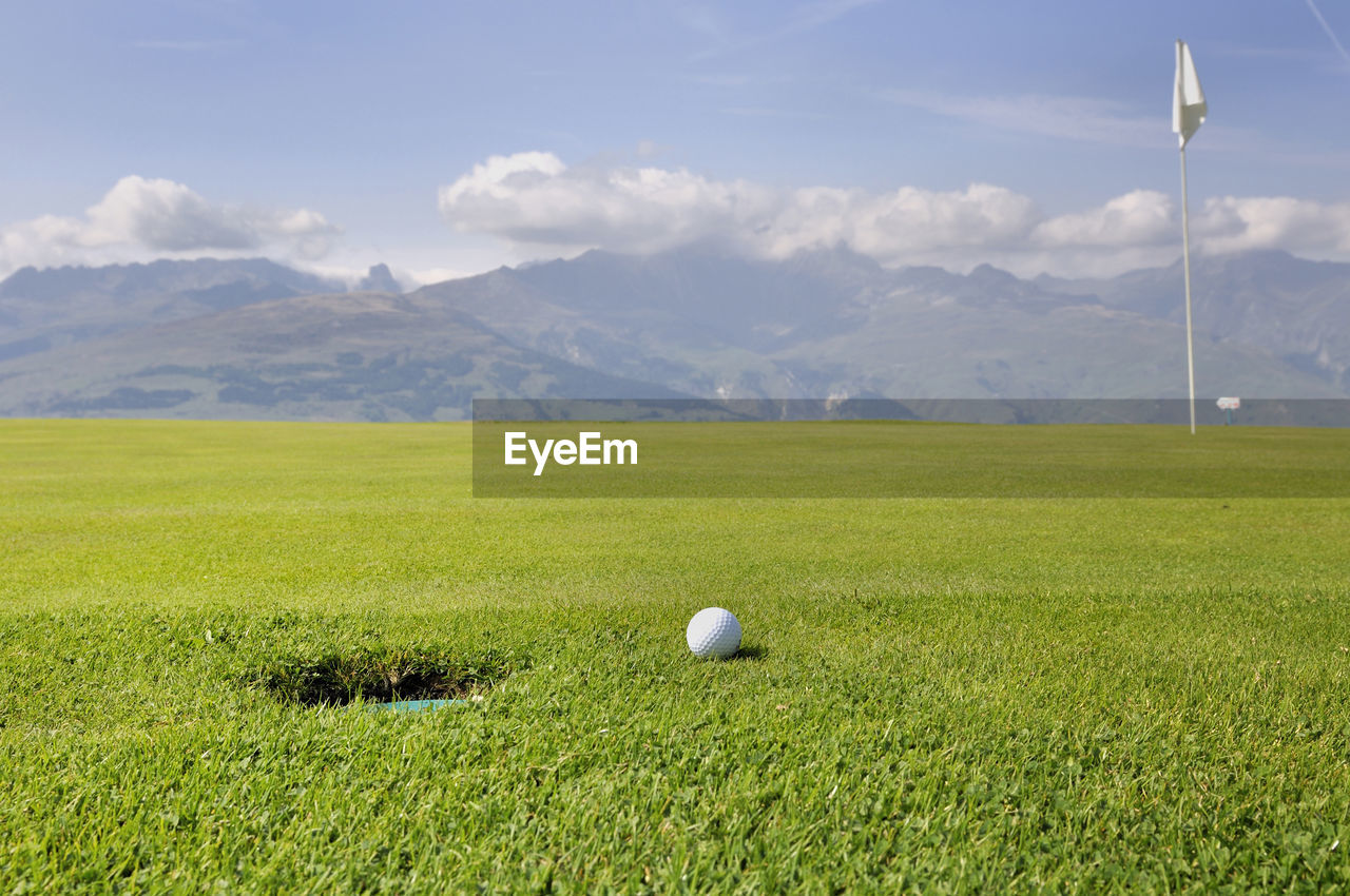 Golf Ball On Field Against Sky