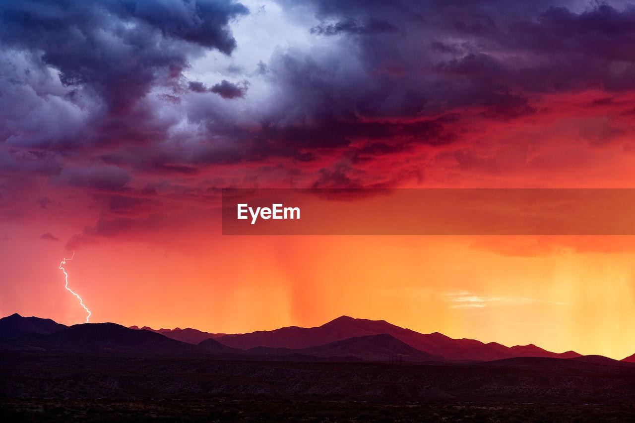 Sunset light illuminates a monsoon thunderstorm near tucson, arizona.