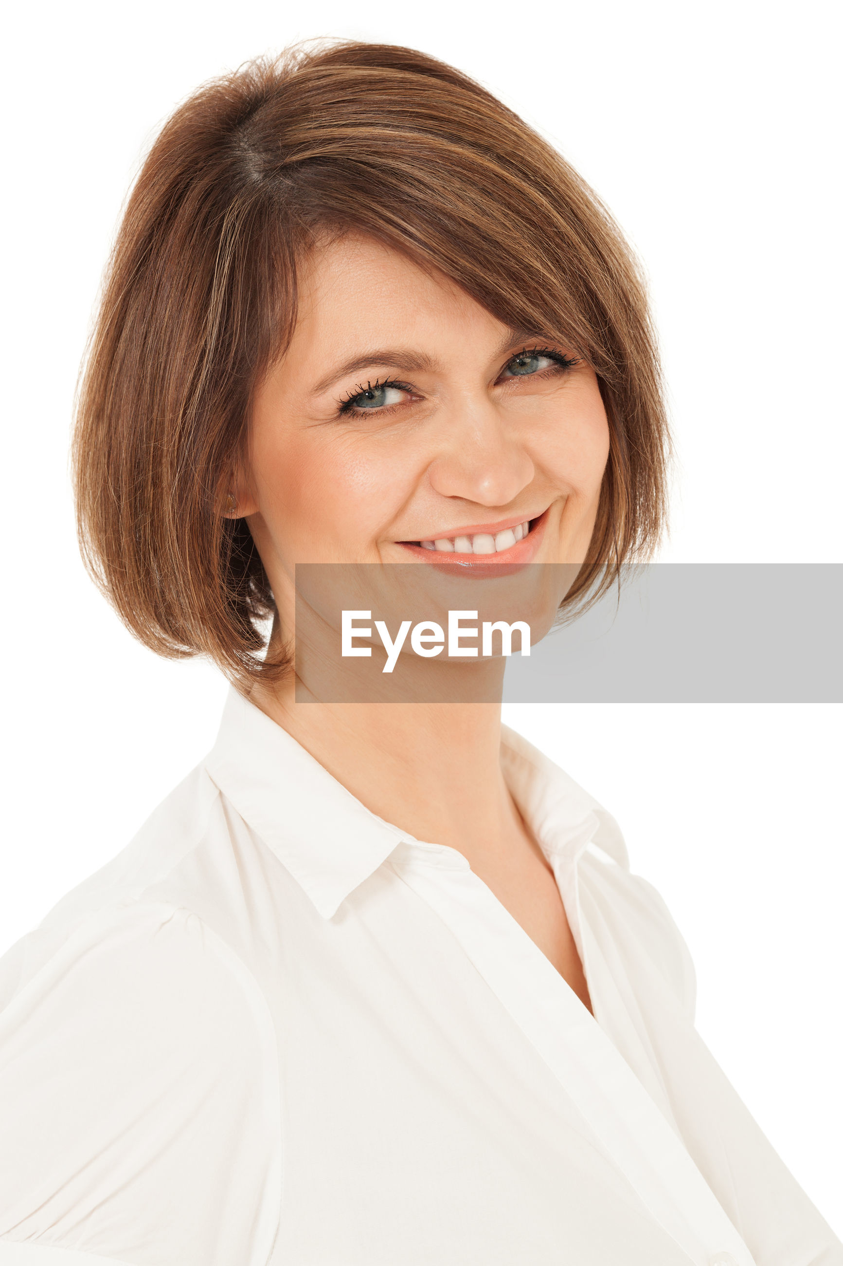 Close-up portrait of woman against white background