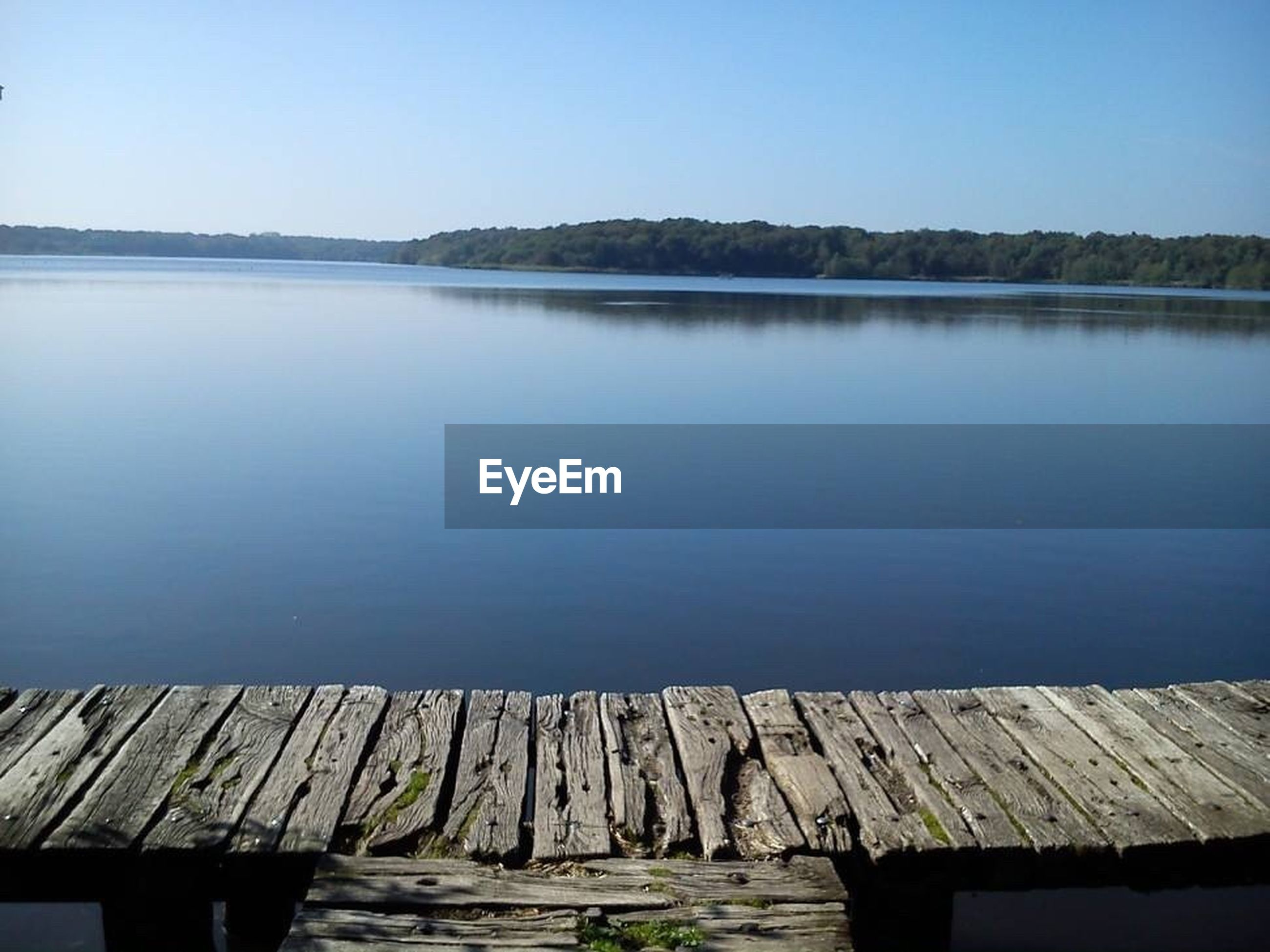 water, tranquil scene, tranquility, lake, clear sky, scenics, wood - material, blue, beauty in nature, nature, pier, copy space, idyllic, jetty, wood, calm, wooden, day, rippled, reflection