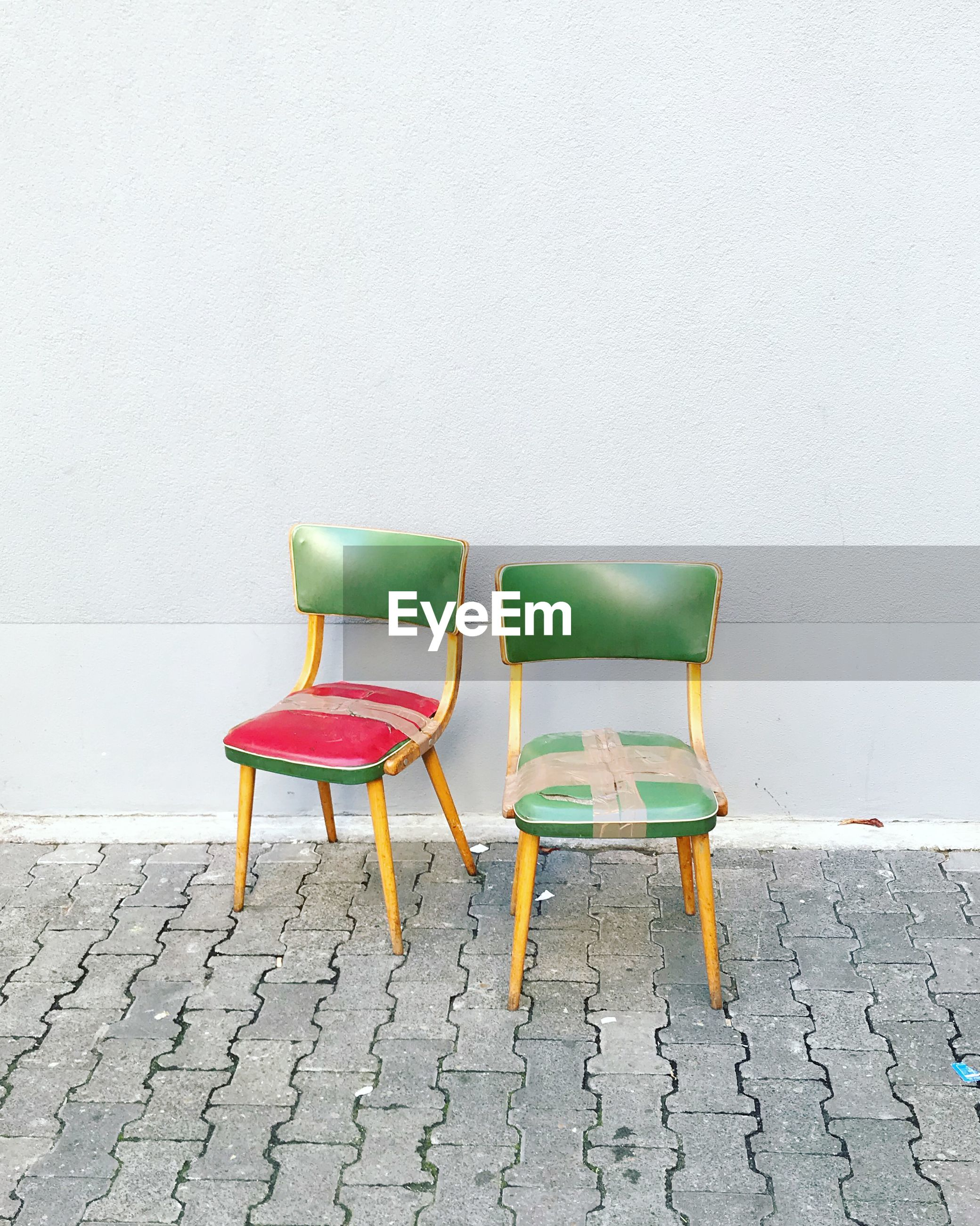 EMPTY CHAIR AGAINST WHITE BACKGROUND