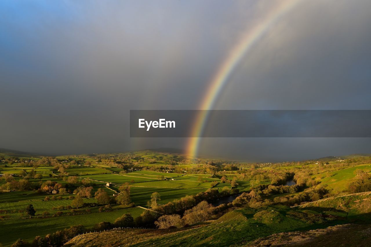 rainbow, scenics - nature, beauty in nature, environment, landscape, sky, tranquil scene, double rainbow, idyllic, tranquility, non-urban scene, nature, cloud - sky, no people, field, land, day, multi colored, plant, outdoors