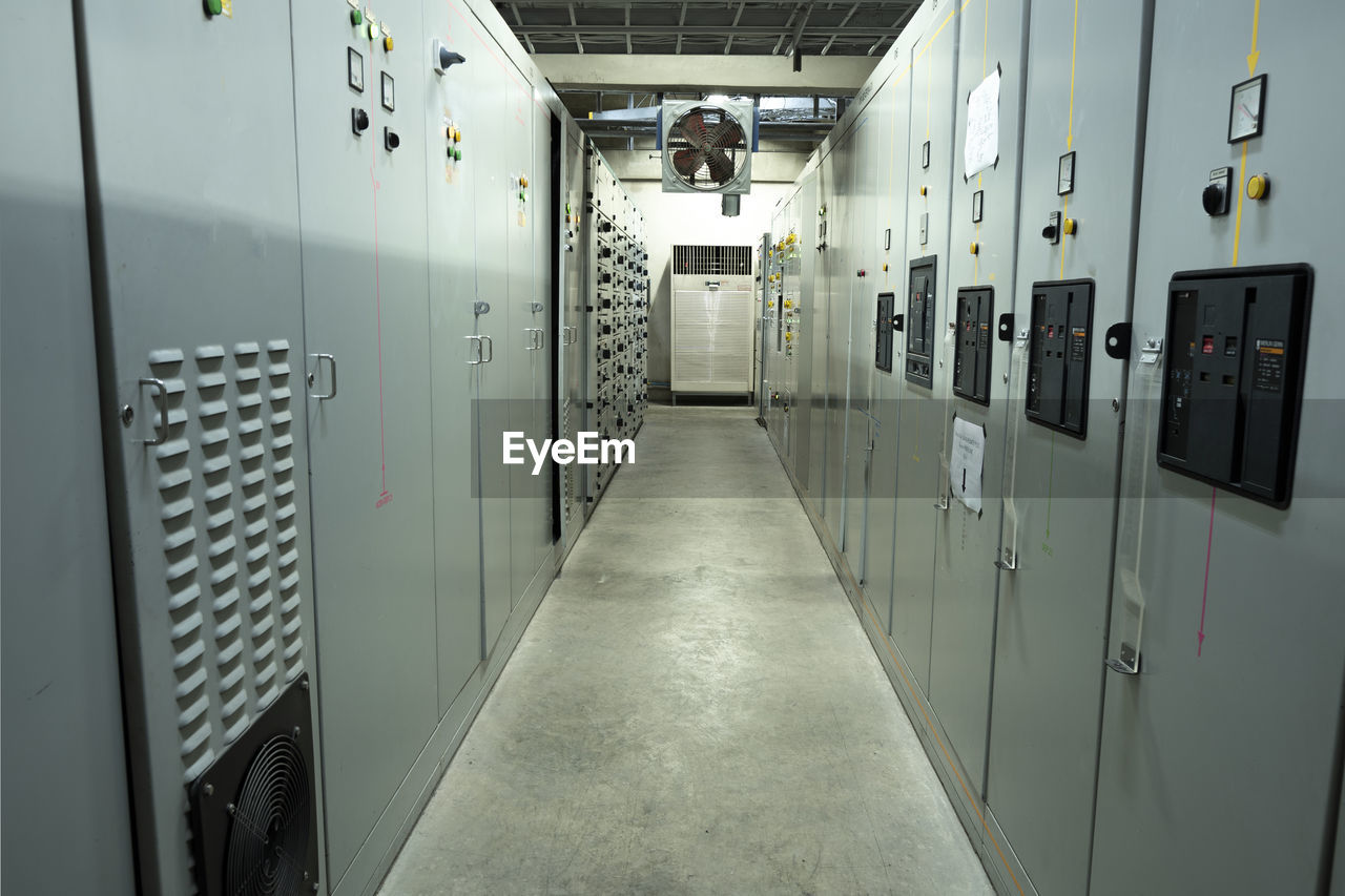 indoors, locker, corridor, architecture, safety, arcade, building, security, dressing room, illuminated, protection, locker room, in a row, metal, no people, technology, control, door, electricity, closed