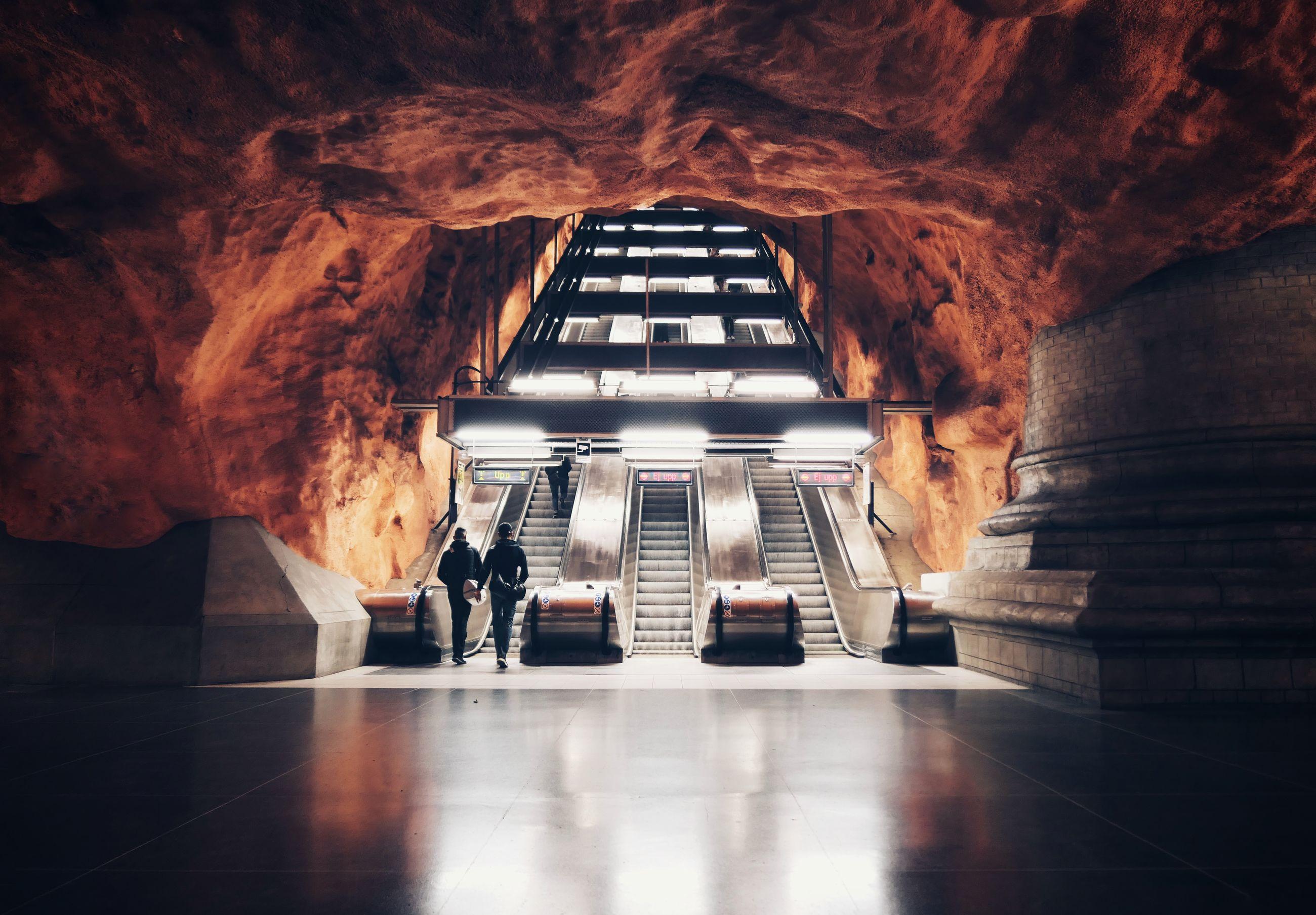 Illuminated escalator in cave