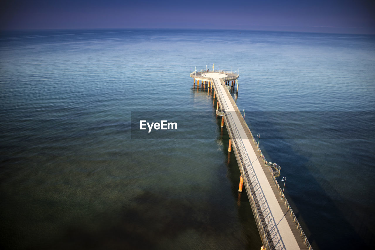 water, sea, sky, no people, nature, scenics - nature, fuel and power generation, industry, high angle view, outdoors, day, tranquility, horizon, transportation, beauty in nature, horizon over water, tranquil scene, oil industry, reflection