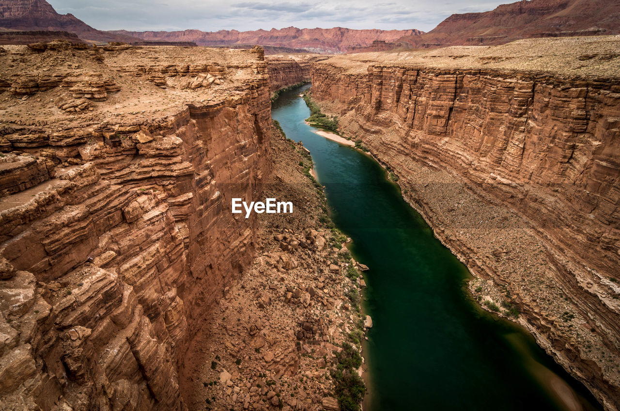 Scenic View Of River And Rock Formations