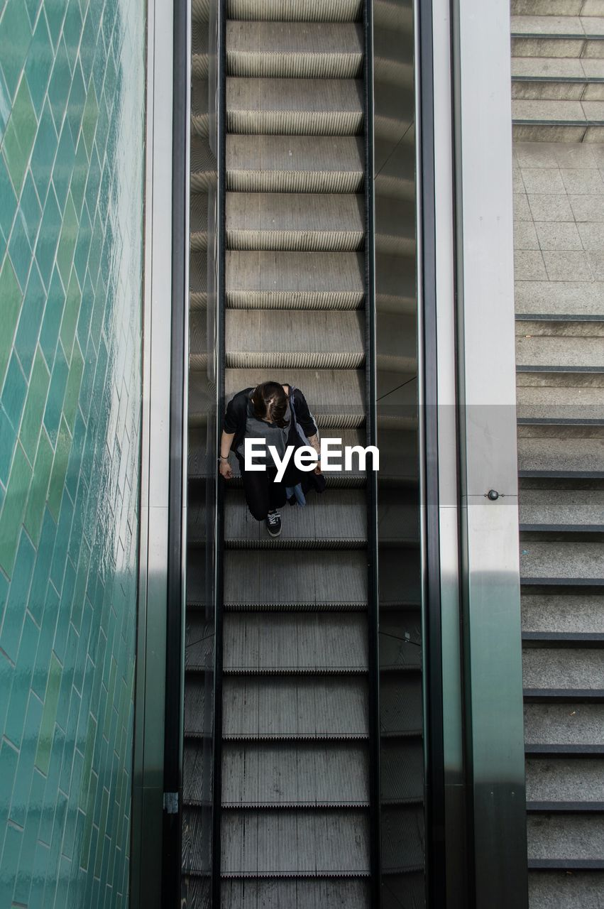 Directly Above View Of Woman On Escalator