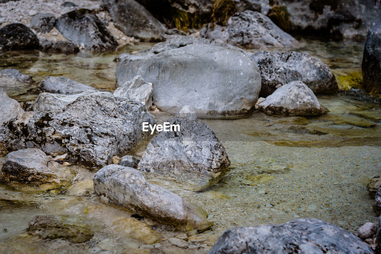 rock, solid, rock - object, water, nature, no people, day, land, textured, beauty in nature, tranquility, outdoors, stone, rock formation, stream - flowing water, geology, sea, wet, rough, flowing water, shallow