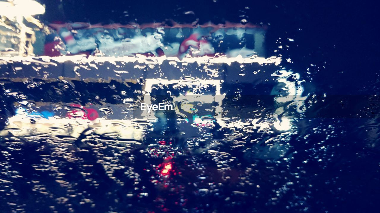 car, vehicle interior, land vehicle, glass - material, car interior, transportation, window, mode of transport, windshield, wet, drop, close-up, water, no people, raindrop, looking through window, road, day, indoors, full frame, car point of view, backgrounds, illuminated, car wash