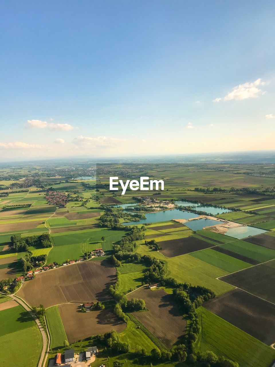 landscape, sky, environment, scenics - nature, patchwork landscape, agriculture, field, beauty in nature, rural scene, aerial view, farm, nature, tranquil scene, day, land, tranquility, plant, cloud - sky, green color, no people, outdoors