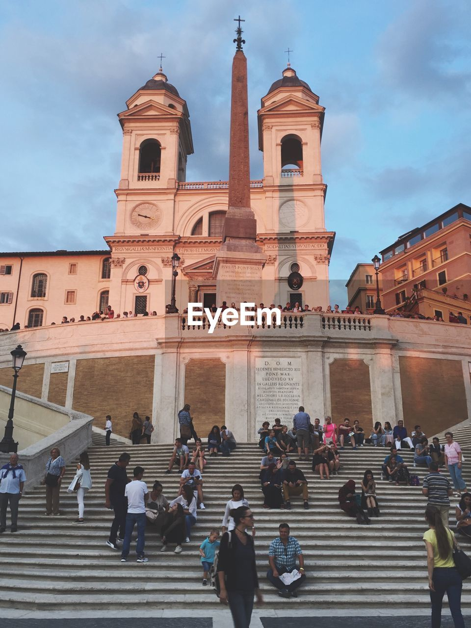 large group of people, architecture, built structure, steps, real people, building exterior, steps and staircases, men, sky, staircase, women, travel destinations, lifestyles, cloud - sky, tourism, religion, spirituality, walking, leisure activity, place of worship, day, outdoors, travel, low angle view, city, adult, people