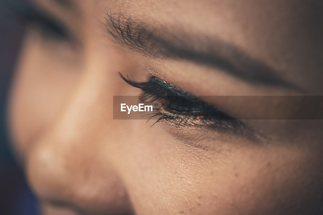 Close-up of woman eye looking away