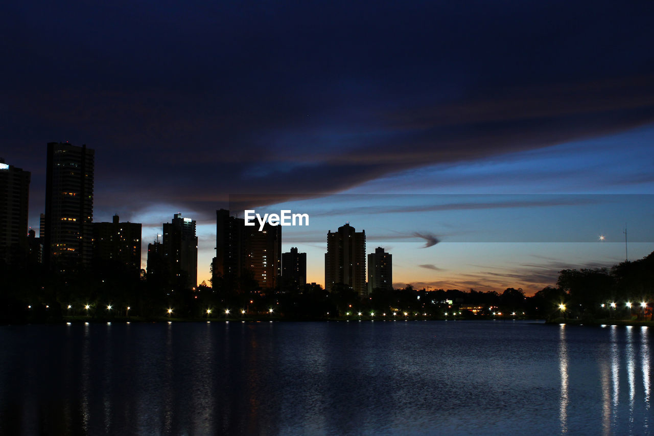 illuminated, night, architecture, building exterior, water, sky, skyscraper, built structure, waterfront, no people, travel destinations, river, cityscape, modern, outdoors, city, nature, beauty in nature, urban skyline