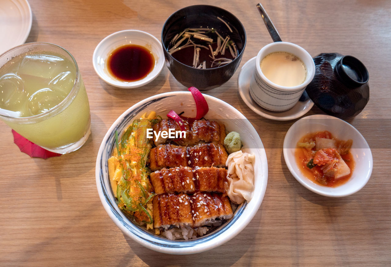 food and drink, table, food, freshness, ready-to-eat, bowl, drink, high angle view, refreshment, indoors, healthy eating, glass, still life, no people, wellbeing, household equipment, drinking glass, serving size, asian food, meal, tray, temptation