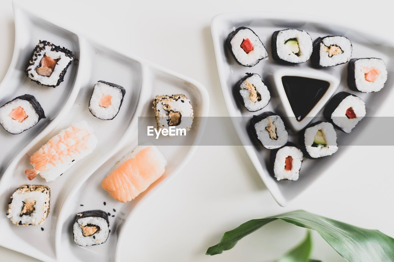 food, food and drink, directly above, indoors, freshness, plate, still life, ready-to-eat, indulgence, bowl, table, no people, healthy eating, high angle view, wellbeing, choice, sweet food, sushi, temptation, serving size, tray, japanese food