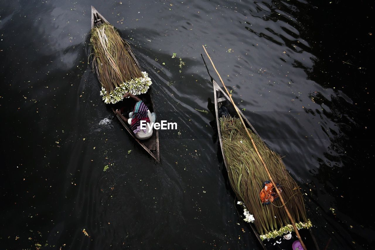 High angle view of man sailing boat on river