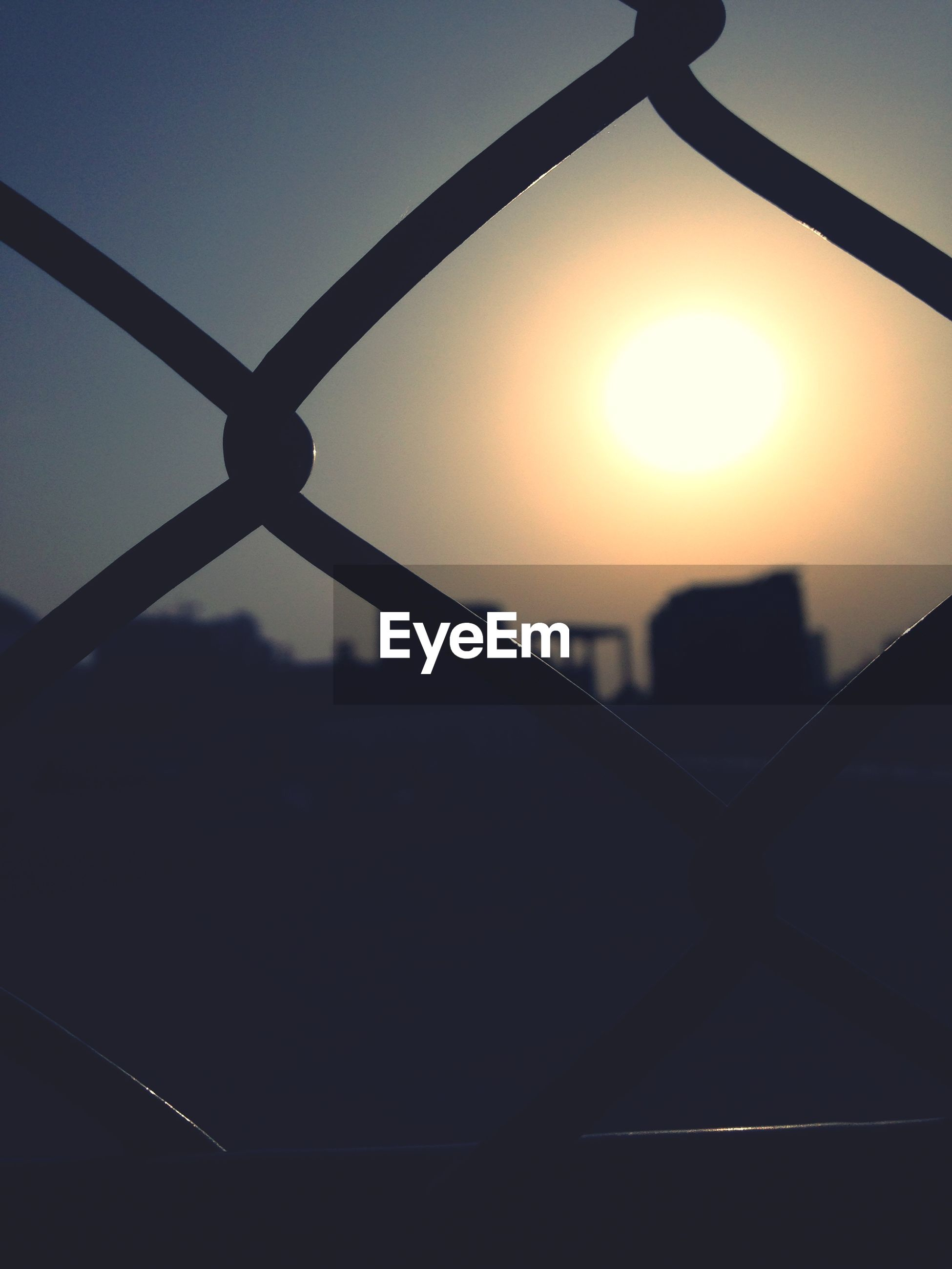 sun, sunset, metal, silhouette, sunlight, sky, chainlink fence, protection, fence, safety, sunbeam, lens flare, orange color, security, connection, built structure, metallic, no people, outdoors, nature