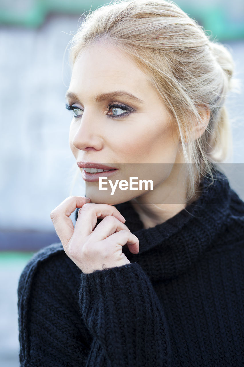 Close-Up Of Thoughtful Woman Wearing Black Turtleneck