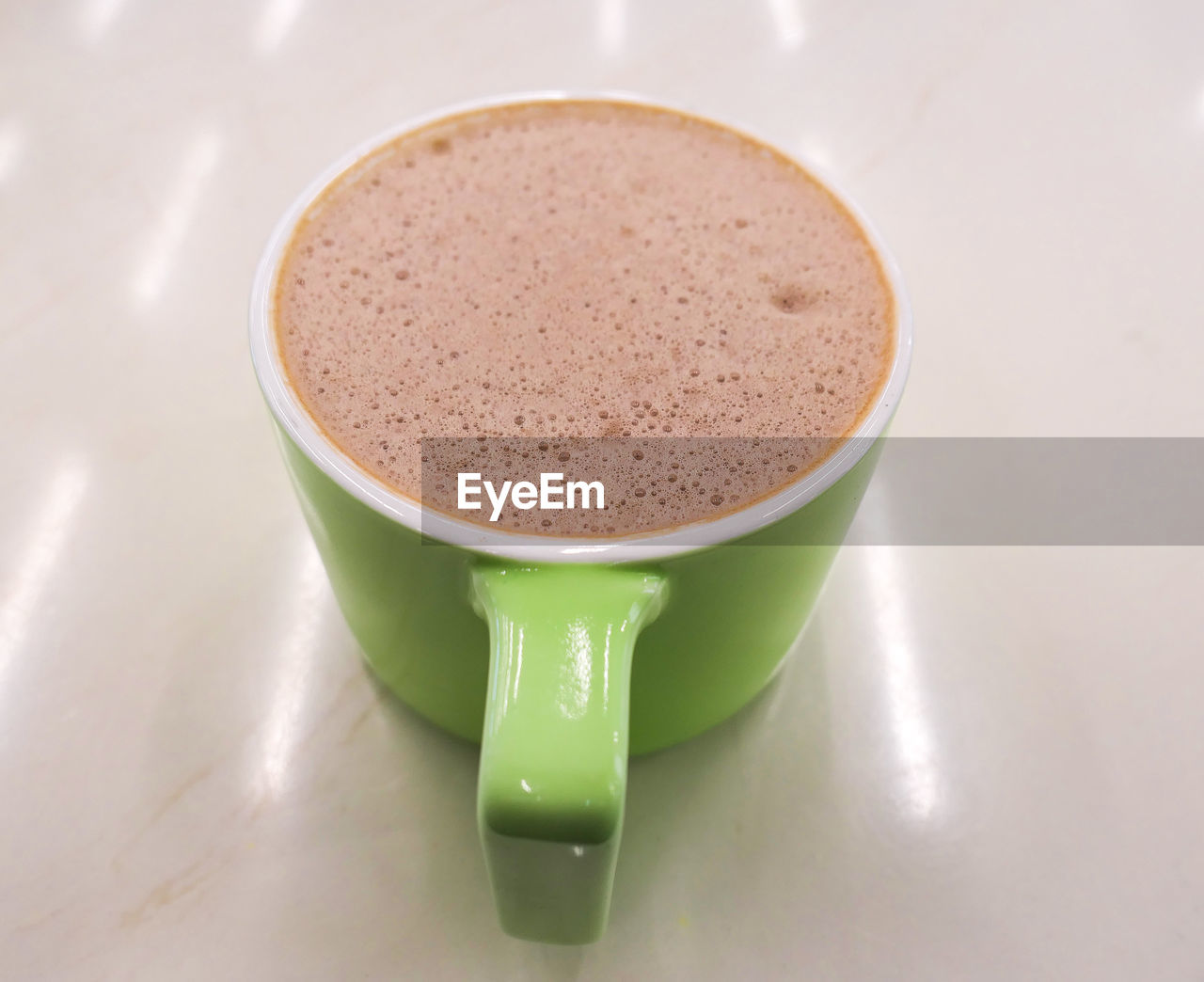 cup, food and drink, drink, still life, mug, coffee cup, refreshment, table, coffee, close-up, freshness, coffee - drink, indoors, frothy drink, no people, high angle view, food, brown, green color, hot drink, non-alcoholic beverage, crockery, froth