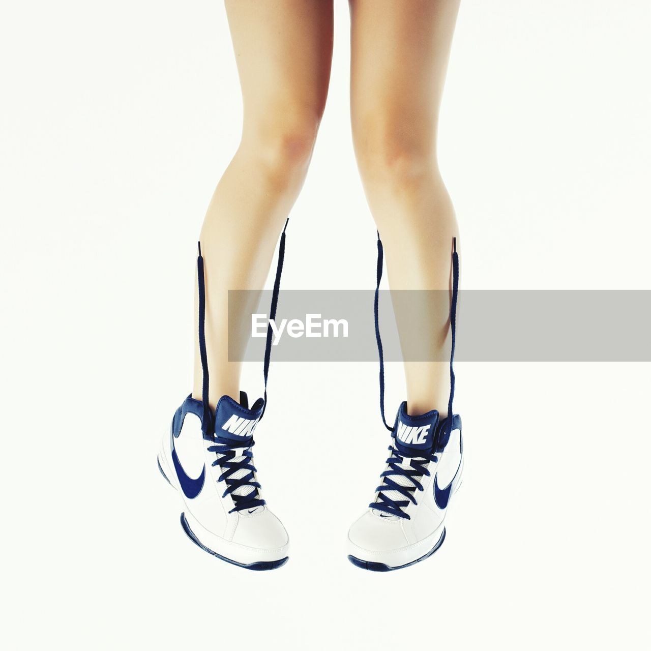 low section, white background, studio shot, shoe, human leg, standing, one person, indoors, close-up, day, people