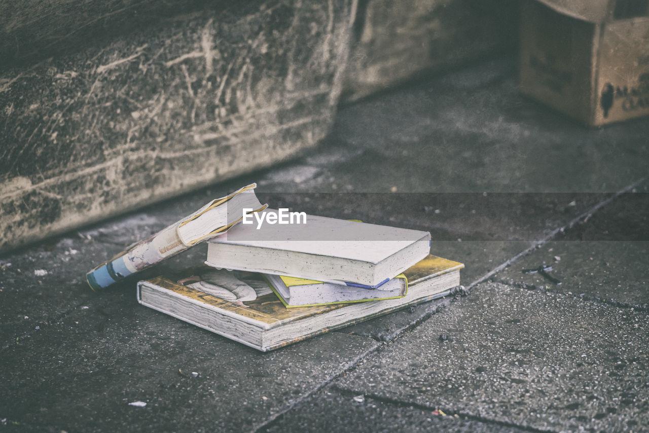 Abandoned books on footpath