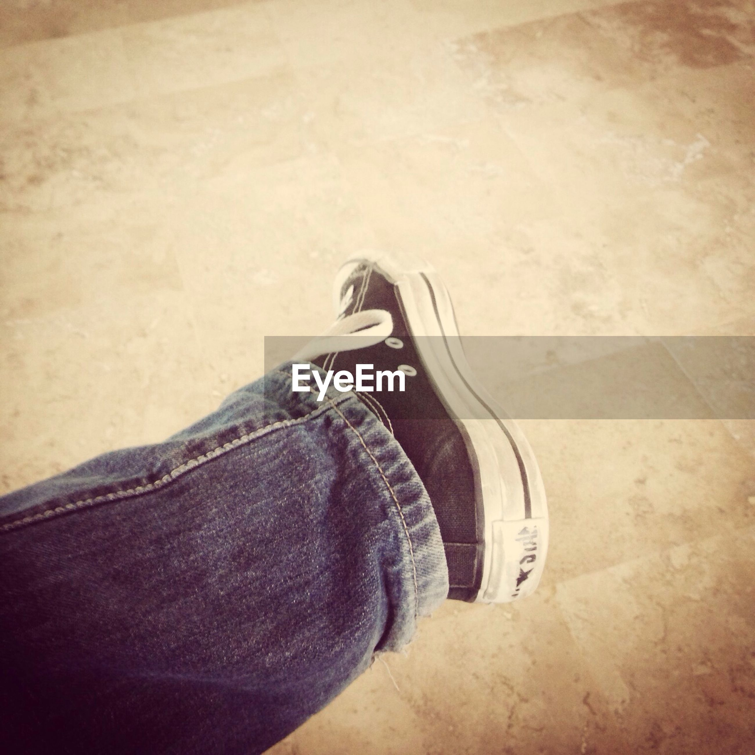 low section, shoe, person, personal perspective, standing, lifestyles, high angle view, jeans, footwear, men, leisure activity, unrecognizable person, human foot, casual clothing, day, shadow, street