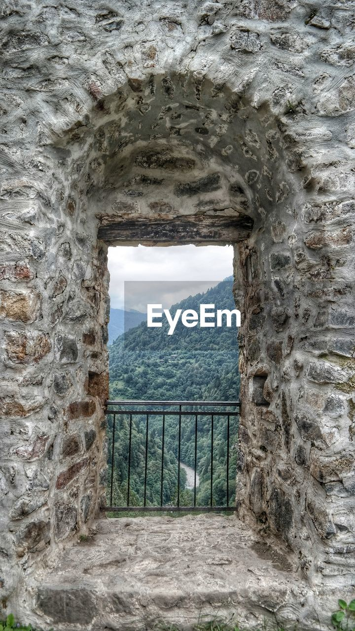 window, tree, day, architecture, built structure, no people, indoors, nature, sky, mountain, scenics, beauty in nature