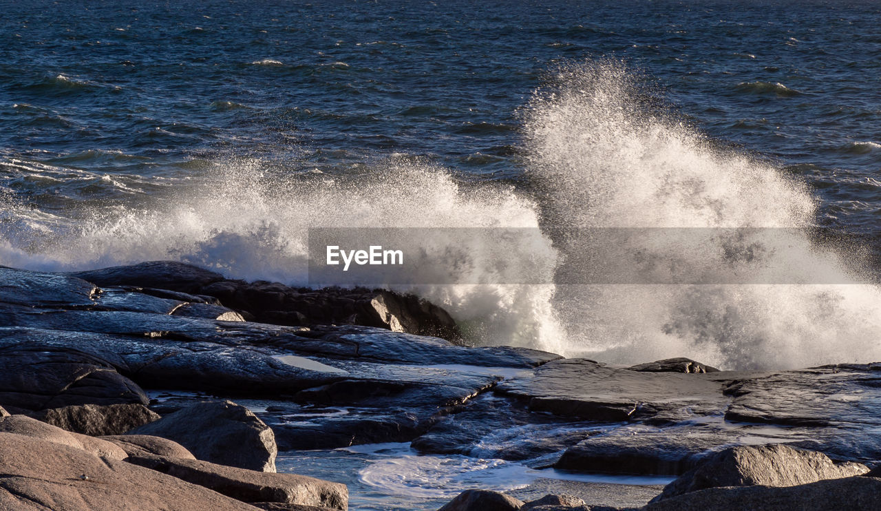 water, motion, sea, power, wave, beauty in nature, power in nature, splashing, rock, crash, nature, no people, force, rock - object, day, hitting, solid, scenics - nature, breaking, outdoors, flowing water