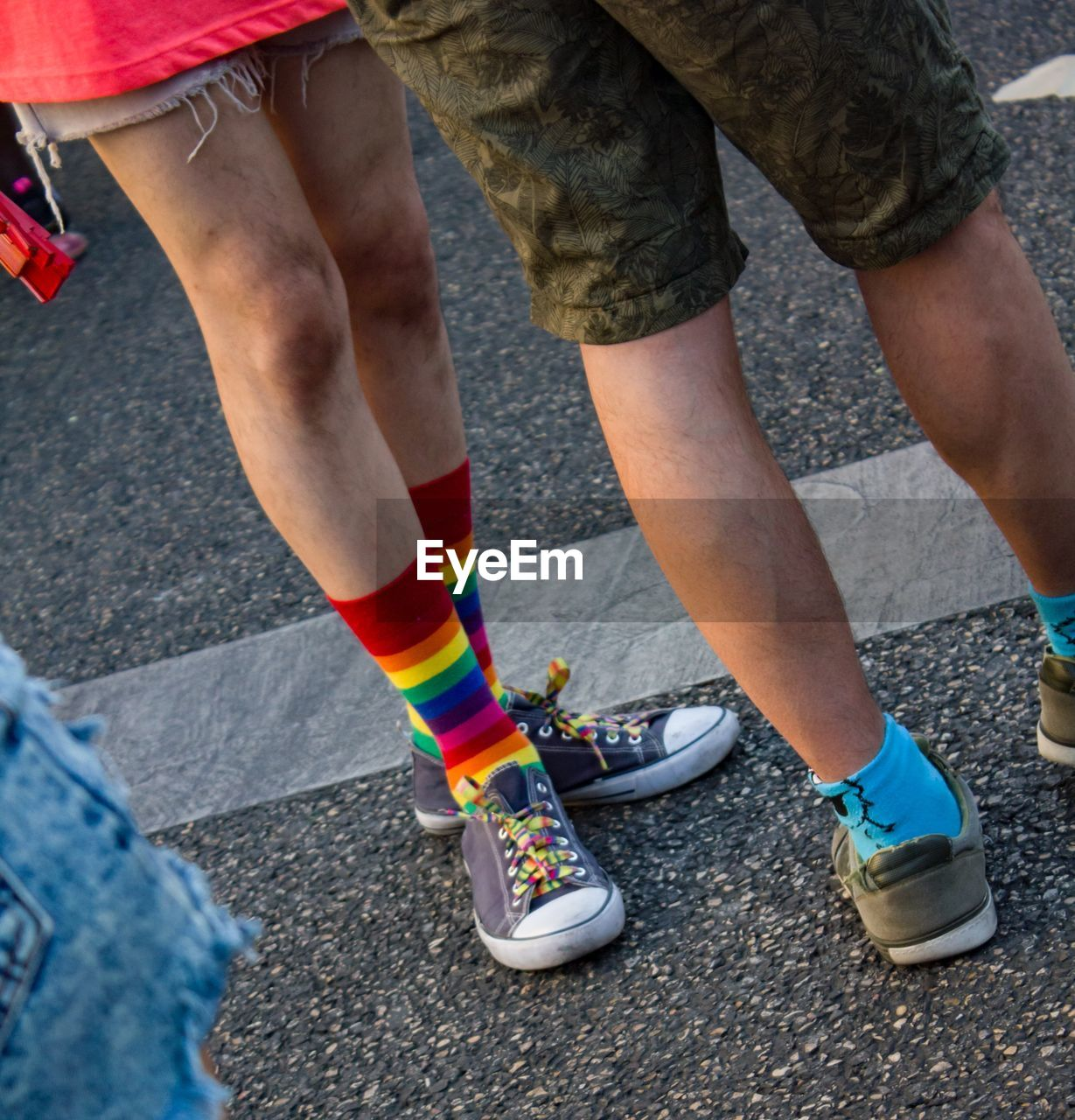 human leg, low section, body part, shoe, human body part, real people, city, day, sport, lifestyles, people, two people, street, road, men, togetherness, leisure activity, outdoors, standing, sports shoe, shorts, human limb, human foot