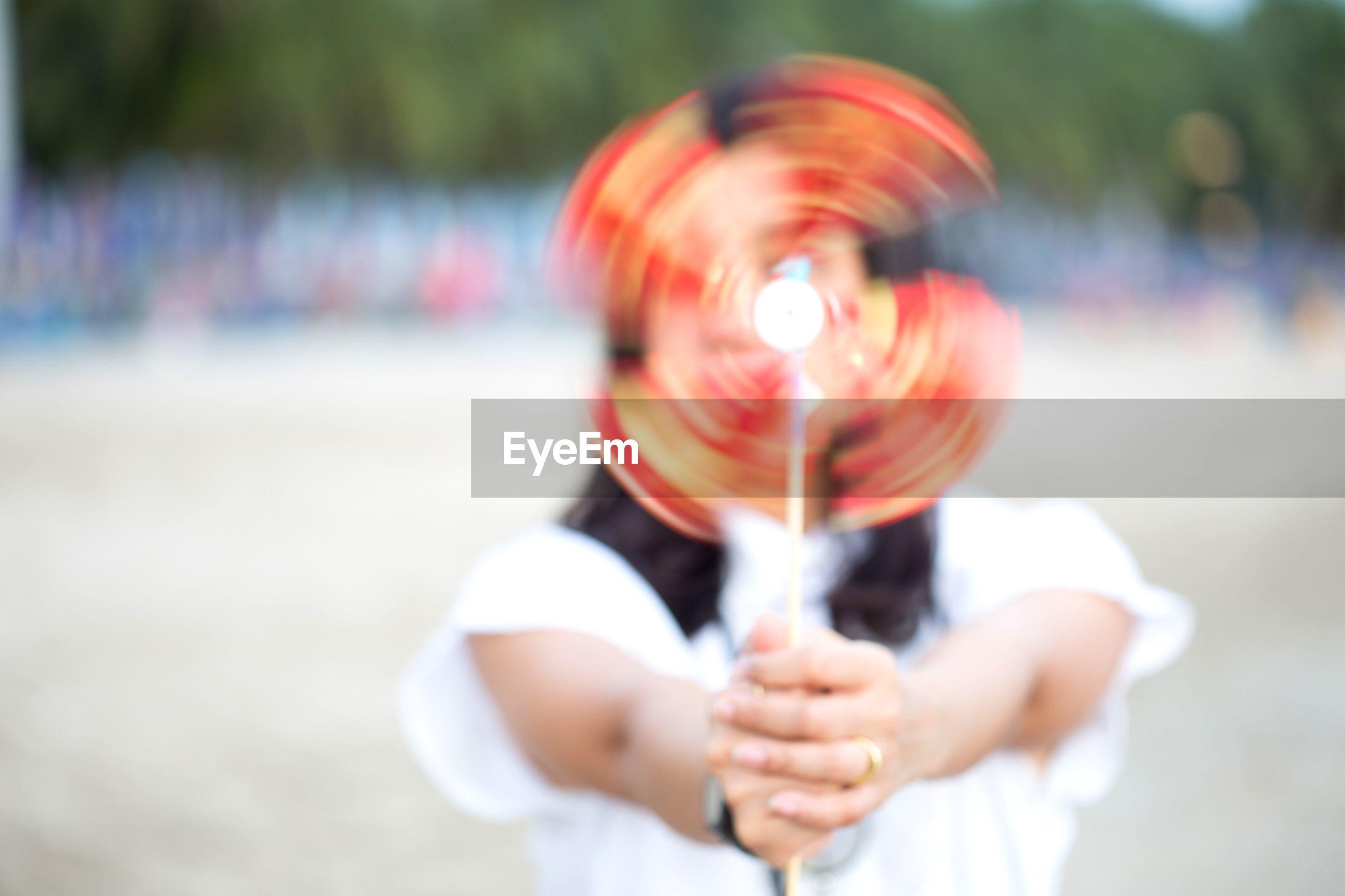 Woman holding spinning pinwheel toy