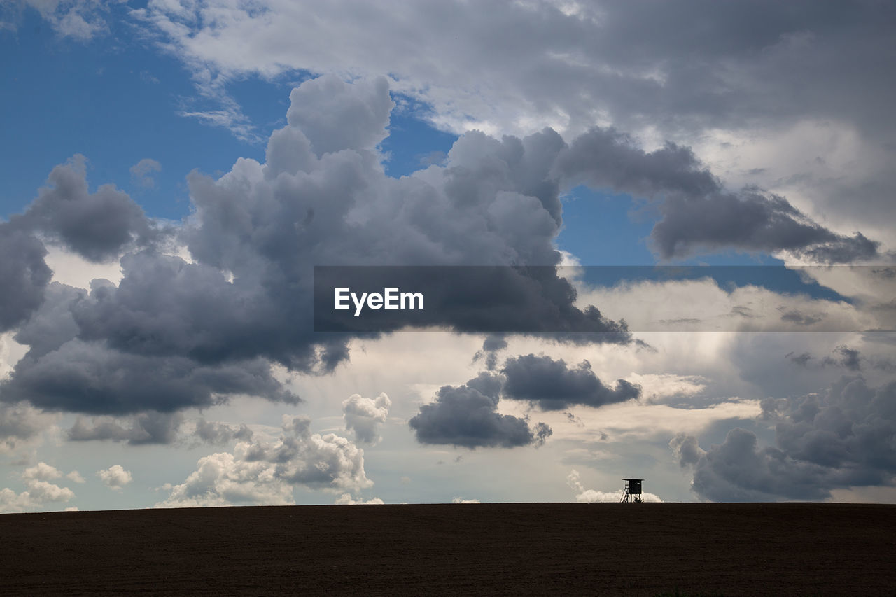 cloud - sky, sky, nature, field, tranquility, landscape, beauty in nature, scenics, tranquil scene, day, outdoors, no people