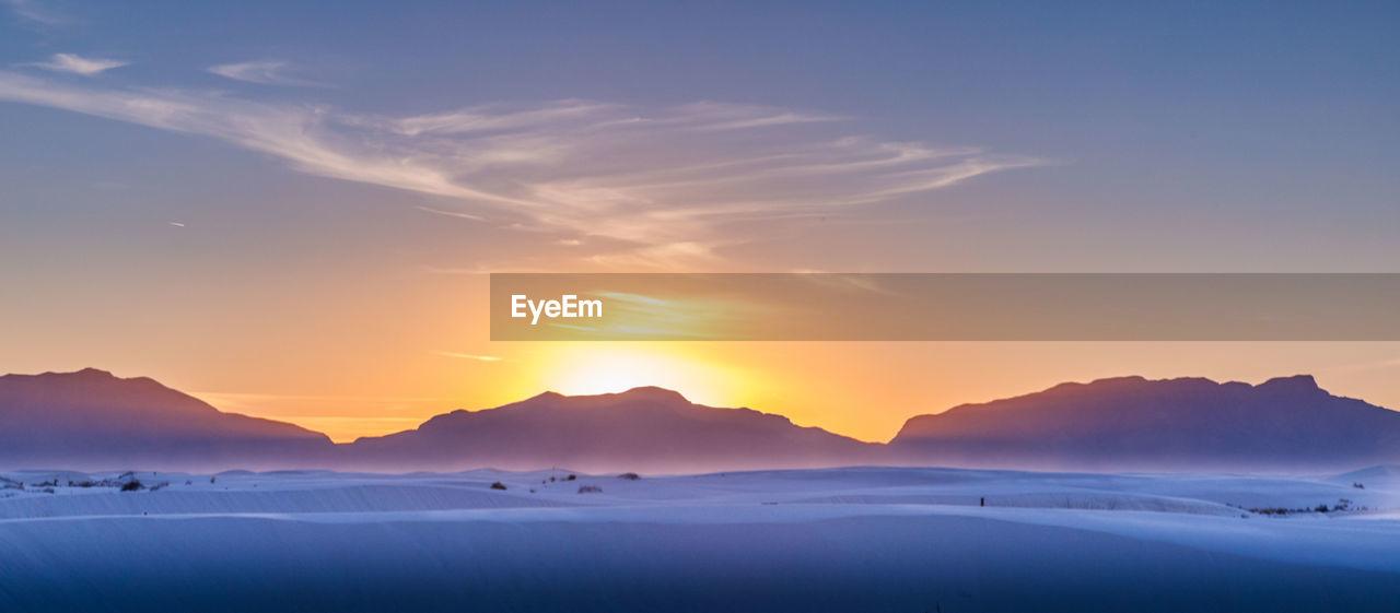 sky, beauty in nature, scenics - nature, sunset, tranquility, tranquil scene, orange color, idyllic, cloud - sky, mountain, non-urban scene, cold temperature, water, nature, winter, no people, sea, remote