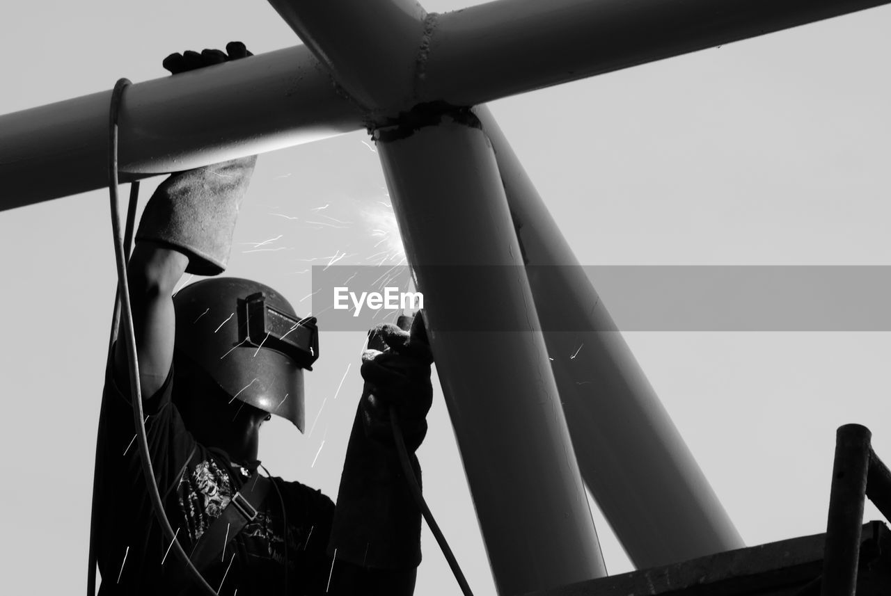 Low Angle View Of Industry Worker With Welding Steel Repairing Metal