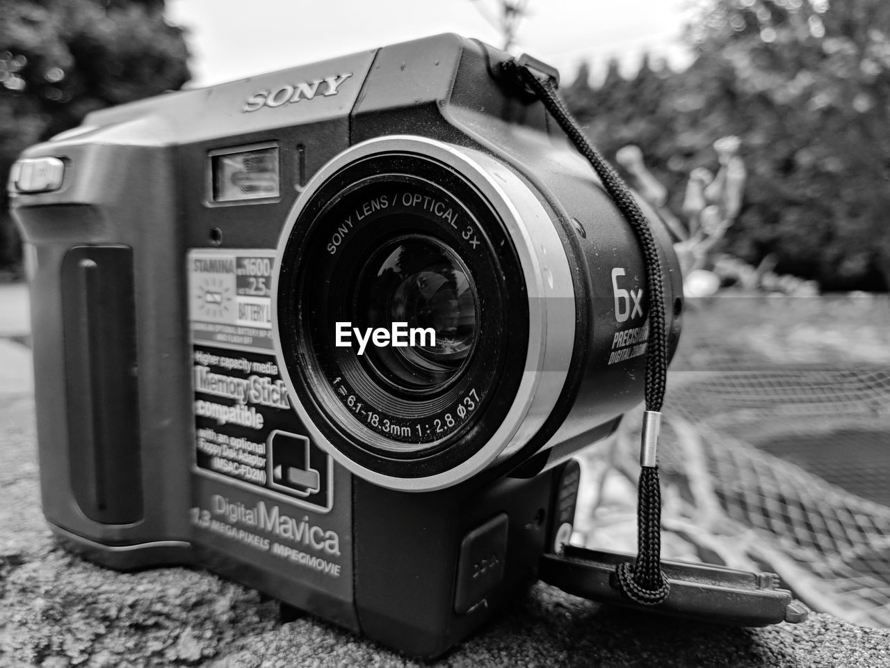 technology, camera - photographic equipment, photography themes, focus on foreground, close-up, photographic equipment, lens - optical instrument, camera, digital camera, no people, equipment, retro styled, day, still life, photographing, single object, number, modern, text, slr camera