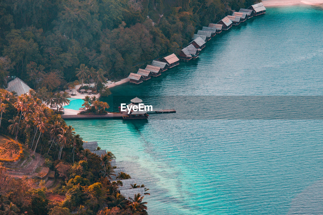 water, nautical vessel, transportation, mode of transportation, day, high angle view, scenics - nature, nature, tree, beauty in nature, plant, no people, sea, waterfront, tranquility, tranquil scene, outdoors, travel, non-urban scene