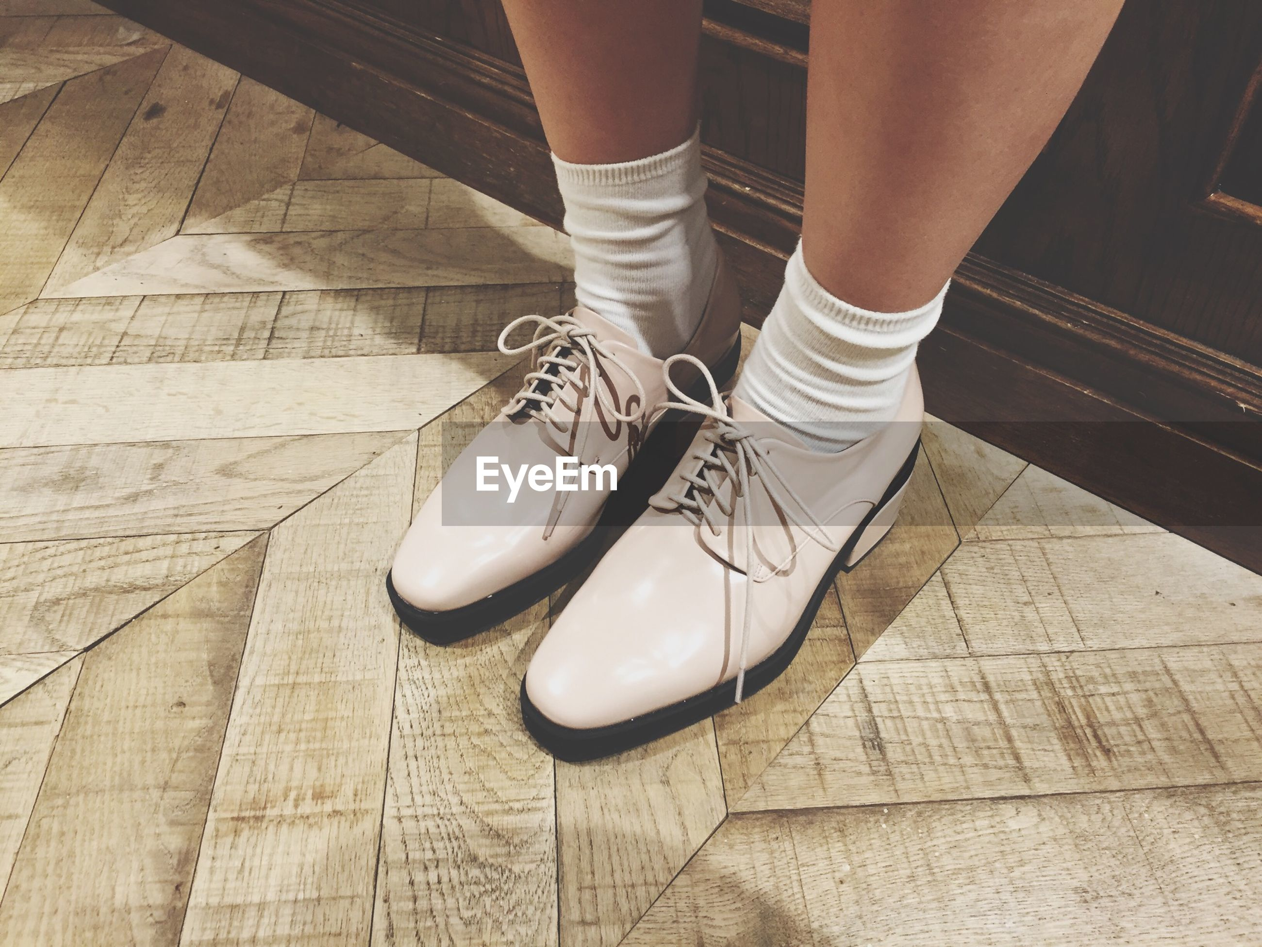 low section, person, shoe, lifestyles, footwear, standing, human foot, high angle view, men, indoors, leisure activity, part of, flooring, sunlight, tiled floor, jeans