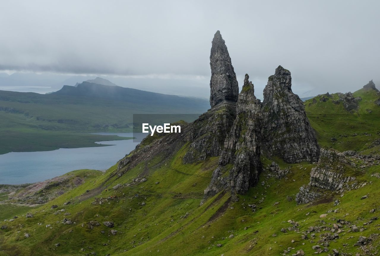 Scenic View Of Old Man Of Storr Against Mountains