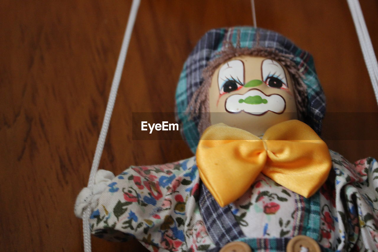 human representation, creativity, art and craft, indoors, no people, close-up, wood - material, table, doll, anthropomorphic face, day, clown