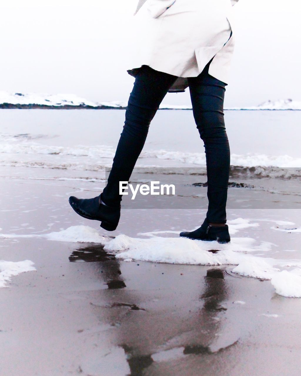 winter, beach, sea, snow, cold temperature, standing, one person, sand, low section, real people, water, nature, frozen, outdoors, day, horizon over water, sky, beauty in nature, ice skate, energetic, people