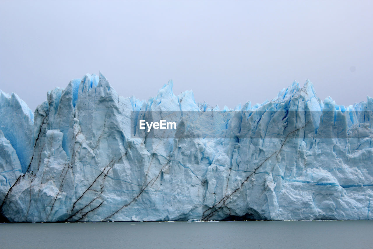 Scenic view of icebergs against clear sky